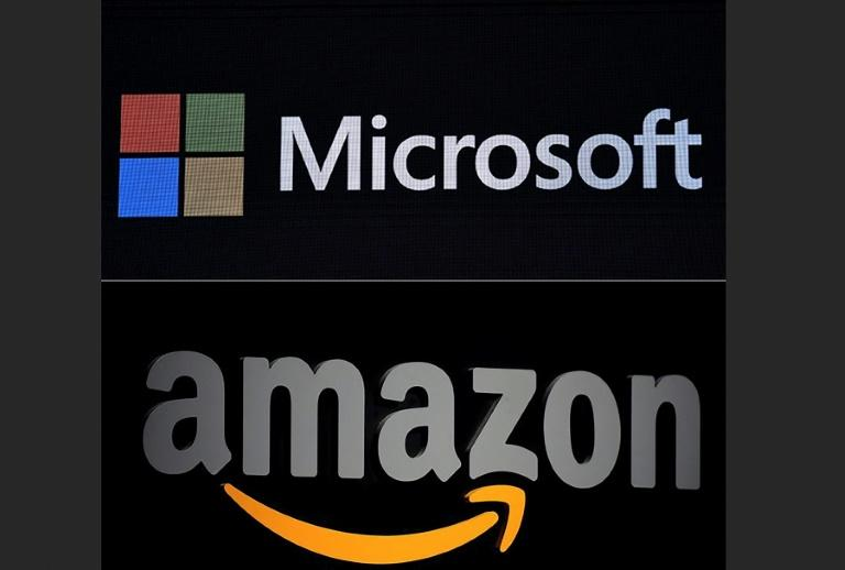 Amazon is challenging the Pentagon's decision to award a $10 billion cloud computing contract to Microsoft, claiming the process was tainted by President Donald Trump's intervention (AFP Photo/Emmanuel DUNAND, Gabriel BOUYS)