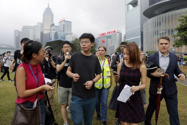 Pro-democracy activist Joshua Wong, centre, speaks to protesters near the Legislative Council in Hong Kong
