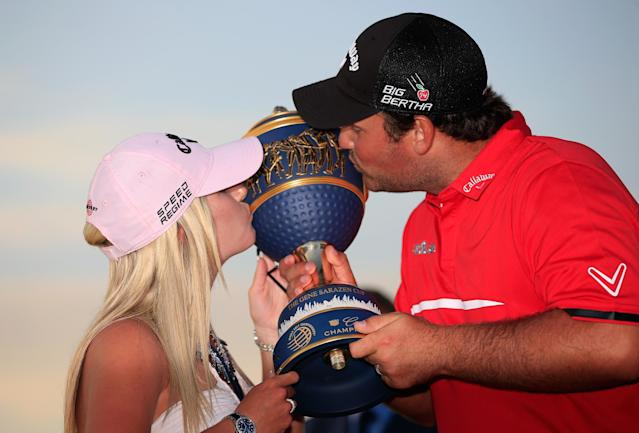 DORAL, FL - MARCH 09: Patrick Reed celebrates with his wife Justine on the 18th green after his one-stroke victory during the final round of the World Golf Championships-Cadillac Championship at Trump National Doral on March 9, 2014 in Doral, Florida. (Photo by Jamie Squire/Getty Images)