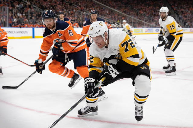 Edmonton Oilers' Adam Larsson (6) defends against Pittsburgh Penguins' Patric Hornqvist (72) during the first period of an NHL hockey game, Tuesday, Oct. 23, 2018 in Edmonton, Alberta. (Codie McLachlan/The Canadian Press via AP)
