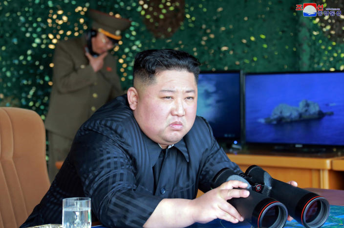 """FILE - This Saturday, May 4, 2019, file photo provided by the North Korean government shows North Korean leader Kim Jong Un, equipped with binoculars, observing tests of different weapons systems, in North Korea. North Korea's test of what appears to be new short-range ballistic missile may not have been a direct threat to the United States, but experts warn it's almost certainly an omen of bigger problems on the horizon. Independent journalists were not given access to cover the event depicted in this image distributed by the North Korean government. The content of this image is as provided and cannot be independently verified. Korean language watermark on image as provided by source reads: """"KCNA"""" which is the abbreviation for Korean Central News Agency. (Korean Central News Agency/Korea News Service via AP, File)"""