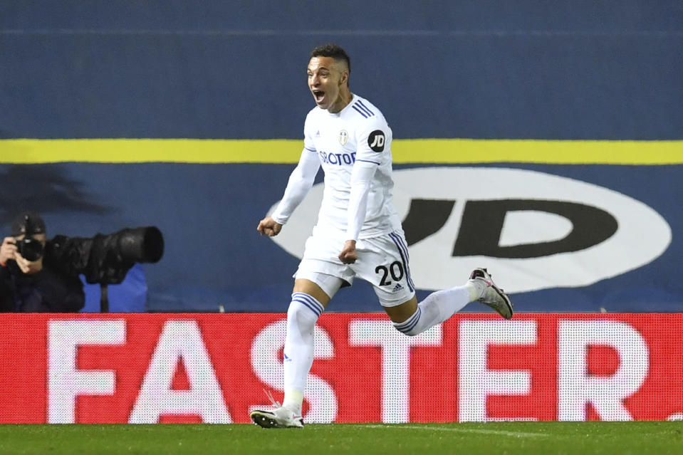 Leeds United's Rodrigo celebrates after scoring his side's first goal during the English Premier League soccer match between Leeds United and Manchester City at Elland Road in Leeds, England, Saturday, Oct. 3, 2020. (Paul Ellis/Pool via AP)