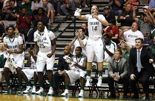 Tulane players celebrate from the bench including Lotanna Nwogbo (25) and Malte Ziegenhagen (14) during the second half of an NCAA college basketball game, Saturday, Jan. 21, 2012, in New Orleans. Tulane won 66-58. (AP Photo/Jonathan Bachman)