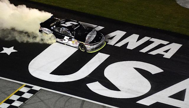 NASCAR Nationwide driver Kevin Harvick does a burn out after he wins the NASCAR Nationwide Cup Series Great Clips 300 auto race at Atlanta Motor Speedway, Saturday, Aug. 30, 2014 in Hampton, Ga. (AP Photo/Joe Sebo)