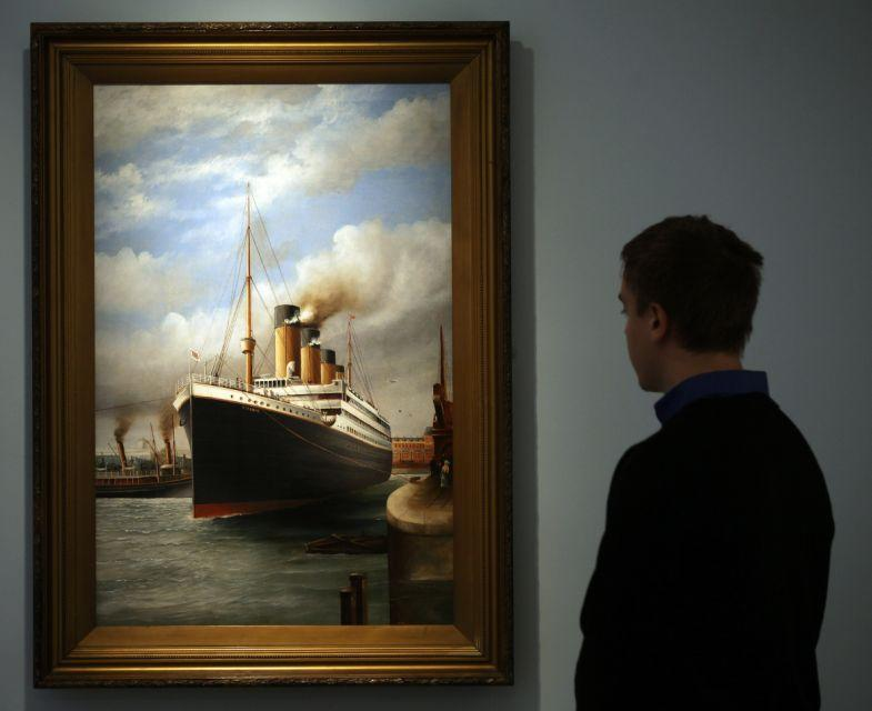 A visitor to SeaCity Museum looks at a painting displayed at the museum's Titanic exhibition on April 3, 2012 in Southampton, England. (Photo by Matt Cardy/Getty Images)