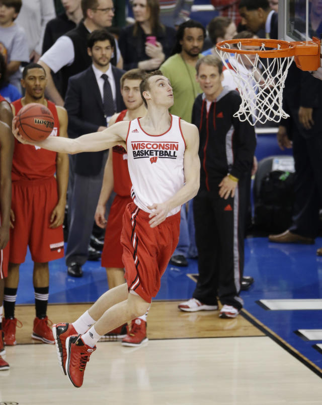 Wisconsin forward Sam Dekker dunks the ball during practice for an NCAA Final Four tournament college basketball semifinal game Friday, April 4, 2014, in Dallas. Wisconsin plays Kentucky on Saturday, April 5, 2014. (AP Photo/Tony Gutierrez)