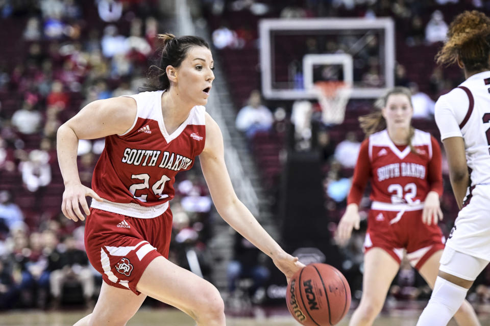South Dakota guard Ciara Duffy (24) drives to the hoop against South Carolina during the first half of an NCAA college basketball game Sunday, Dec. 22, 2019, in Columbia, S.C. (AP Photo/Sean Rayford)