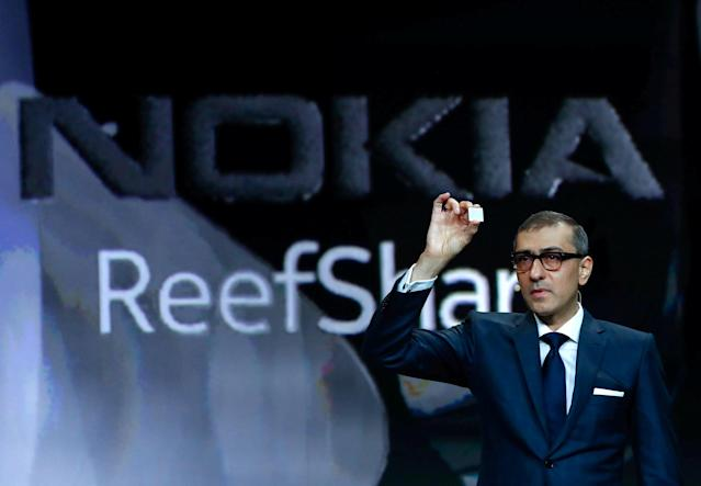 REFILE - CORRECTING BYLINE Rajeev Suri, Nokia's President and Chief Executive Officer, shows a chip during the Mobile World Congress in Barcelona, Spain February 25, 2018. REUTERS/Yves Herman