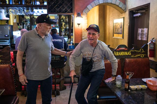 Richard Blakely helps Yarling stand up after dining together at a Mexican restaurant in Austin.