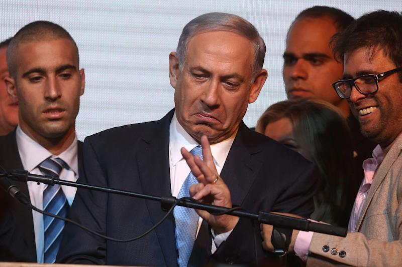 Israeli Prime Minister Benjamin Netanyahu gestures to Likud supporters in Tel Aviv, on March 17, 2015