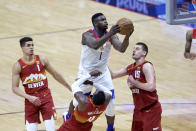 New Orleans Pelicans forward Zion Williamson (1) drives to the basket as Denver Nuggets forward Michael Porter Jr. (1), forward Paul Millsap (4) and center Nikola Jokic (15) defend in the second half of an NBA basketball game in New Orleans, Friday, March 26, 2021. (AP Photo/Rusty Costanza)