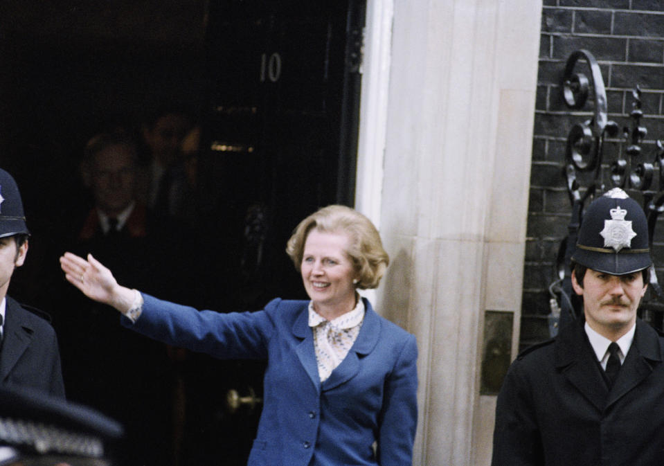 Margaret Thatcher, New British P.M. accompanied by her husband Denis, pictured on steps of No. 10 Downing St. on May 4, 1979 after being asked to form Britain?s new government. Also views of crowds and press. (AP Photo/Dear)