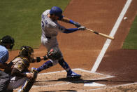 Los Angeles Dodgers' Chris Taylor hits a two-run home run during the second inning of a baseball game against the San Diego Padres, Sunday, April 18, 2021, in San Diego. (AP Photo/Gregory Bull)