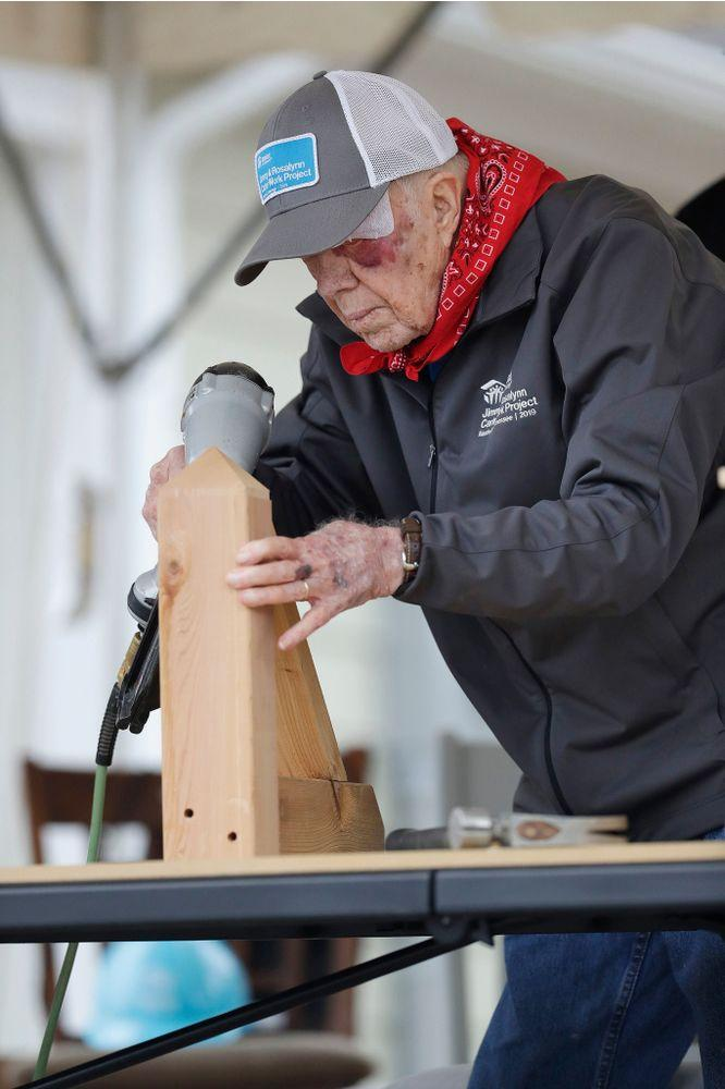 President Jimmy Carter helping build homes for Habitat for Humanity, one day after injuring himself in a fall at his home in October. | Mark Humphrey/AP/Shutterstock