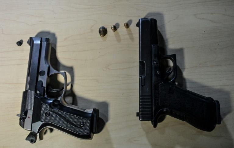 The government is working on a law to regulate imitation guns (AFP/Juan BARRETO)