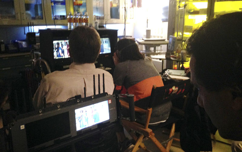 "FILE - In this Feb. 19, 2015 file photo, crew members from NBC's ""The Night Shift,"" watch over filming of an episode at Albuquerque Studios in Albuquerque, N.M. New Mexico's film industry appears to be on the brink of a boom thanks to abortion law controversies in other states and expanded incentives. The Albuquerque Journal reports a recent rise in film productions in the state as Hollywood targets Georgia and Louisiana over recently passed restrictive abortion laws. (AP Photo/Russell Contreras, File)"