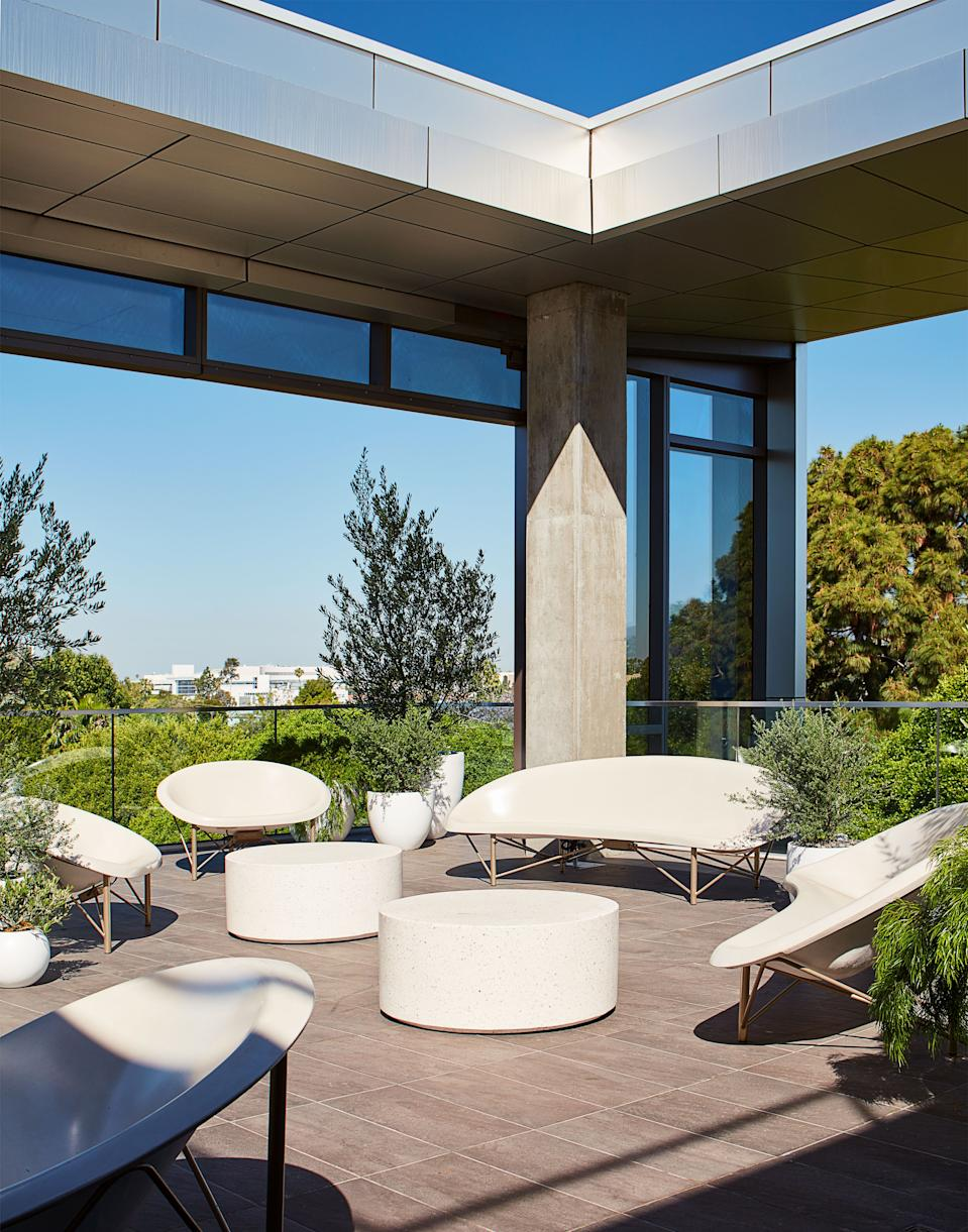 Heated outdoor furniture by Galanter & Jones allows year-round enjoyment of the terrace.
