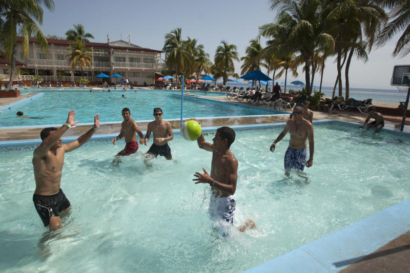 In this June 29, 2013 photo, tourist play pool basketball at Club Indigo beach resort in Montrouis, Haiti. The Haitian government is trying to revive the country's long stagnant tourism industry with investments totaling more than $160 million. Haiti's tourism ministry had about $2 million in its budget under the previous administration, and received another $1 million from a Venezuelan oil fund in the aftermath of a destructive storm season, according to the former tourism minister. Today, the department has a budget that's $4.7 million, plus $27 million from Venezuela's PetroCaribe fund. (AP Photo/Dieu Nalio Chery)