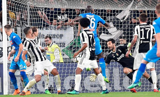 FILE - In this April 22, 2018 file photo, Napoli's Kalidou Koulibaly, top center, scores past Juventus goalkeeper Gianluigi Buffon, second from right, during a Serie A soccer match between Juventus and Napoli at the Allianz Stadium in Turin, Italy. Amid reports of a dressing-room bust up, Juventus can not afford to slip up at bitter rival Inter Milan on Saturday, April 28, 2018. (Alessandro Di Marco/ANSA via AP, file)
