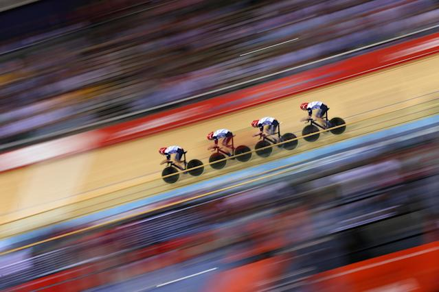 LONDON, ENGLAND - AUGUST 02: Geraint Thomas, Steven Burke, Edward Clancy, and Peter Kennaugh of Great Britain post a new world record time during Men's Team Pursuit Track Cycling Qualifying on Day 6 of the London 2012 Olympic Games at Velodrome on August 2, 2012 in London, England. (Photo by Cameron Spencer/Getty Images)