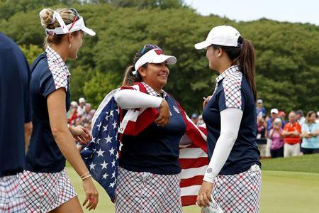 Aug 20, 2017; West Des Moines, IA, USA; USA golfers Lexi Thompson, Lizette Salas and Angel Yin celebrate on the 18th green during the final round of The Solheim Cup international golf tournament at Des Moines Golf and Country Club. Mandatory Credit: Brian Spurlock-USA TODAY Sports