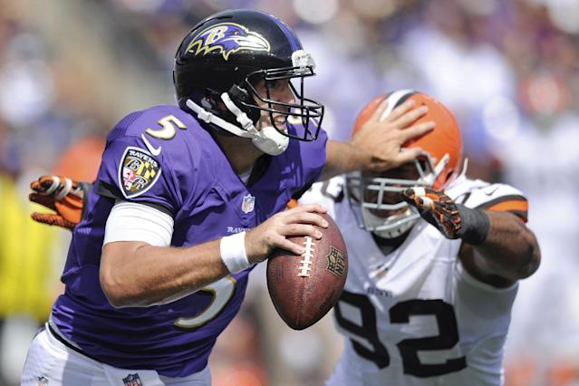 Baltimore Ravens quarterback Joe Flacco (5) pushes off Cleveland Browns defensive end Desmond Bryant's helmet during the first half of a NFL football game in Baltimore, Md., Sunday Sept. 15, 2013. (AP Photo/Nick Wass)
