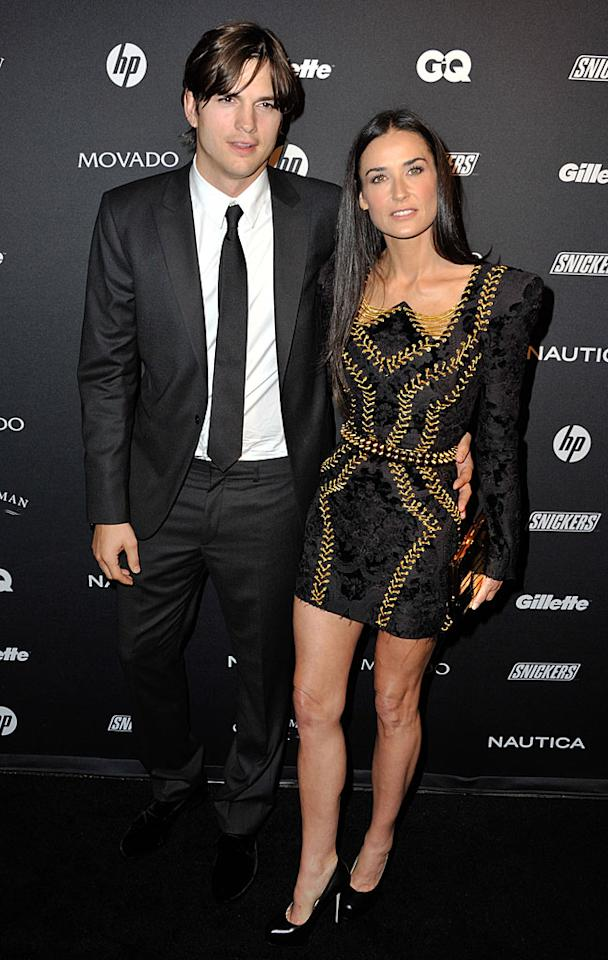 """Ashton Kutcher and wife Demi Moore struck a pose Wednesday at the third annual GQ Gentlemen's Ball to benefit the magazine's Gentlemen's Fund. Despite rumors of Ashton having an affair, the two were <a href=""""http://omg.yahoo.com/news/demi-moore-ashton-kutcher-pack-on-pda-for-the-cameras/49697"""" target=""""new"""">quite affectionate</a>, holding hands and talking softly to each other on the red carpet at NYC's Edison Ballroom. D Dipasupil/<a href=""""http://www.filmmagic.com/"""" target=""""new"""">FilmMagic.com</a> - October 27, 2010"""