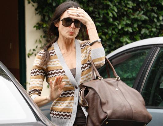 """Demi Moore's publicist confirmed on January 24, 2012 that the actress is being treated for """"stress"""" and """"exhaustion."""" The news comes three months after the actress officially called it quits on her marriage with Ashton Kutcher. Photo: Demi Moore leaving beauty salon looks on Nov 9, 2011"""