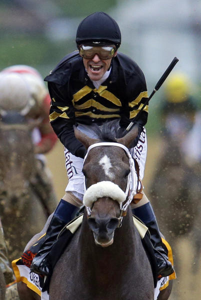 Jockey Gary Stevens celebrates aboard Oxbow after winning the 138th Preakness Stakes horse race at Pimlico Race Course, Saturday, May 18, 2013, in Baltimore. (AP Photo/Patrick Semansky)