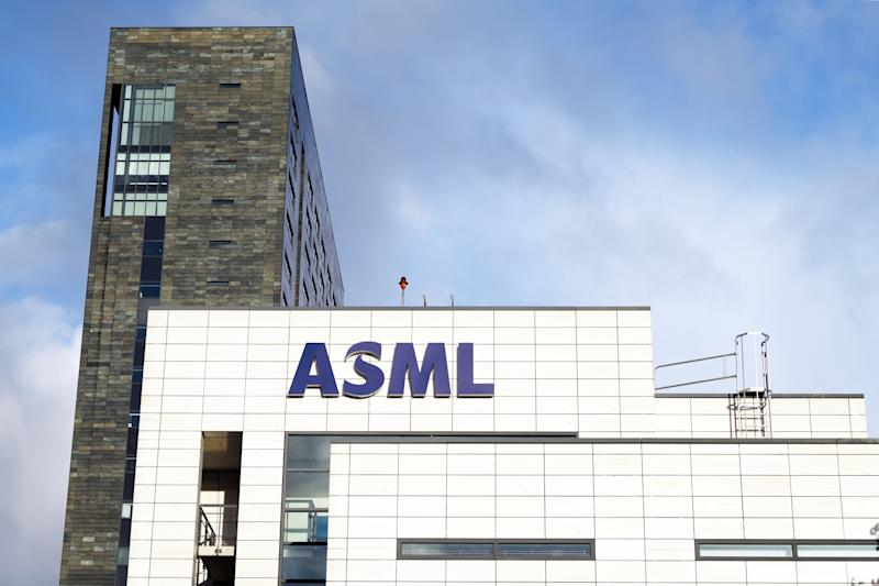 The outside of a white building with the letters ASML on it.