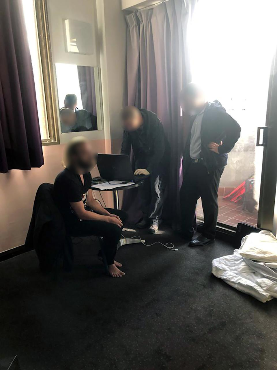 The man being arrested on April 8 last year at a Sydney youth hostel by Australian Federal Police.