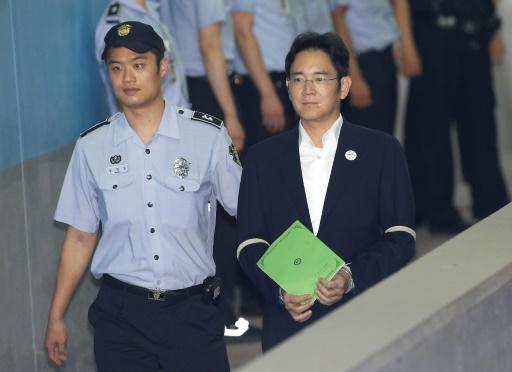 Prosecutors seek 12 years jail for Samsung heir