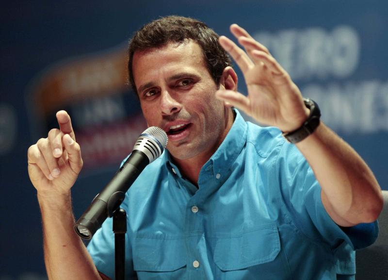 Opposition presidential candidate Henrique Capriles speaks during a news conference with foreign correspondents in Caracas, Venezuela, Monday, Oct. 1, 2012. Venezuela's presidential election is scheduled for Oct. 7. (AP Photo/Fernando Llano)