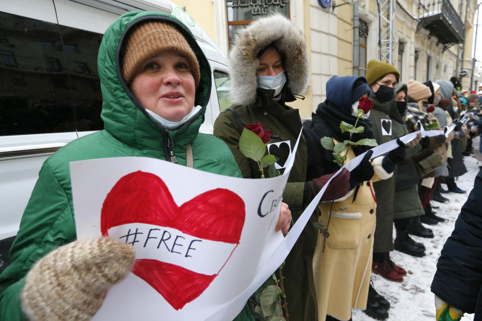 Women, some of them wearing face masks to protect against coronavirus, attend a rally in support of jailed opposition leader Alexei Navalny and his wife Yulia Navalnaya, in Moscow, Russia, Sunday, Feb. 14, 2021. (AP Photo/Alexander Zemlianichenko)