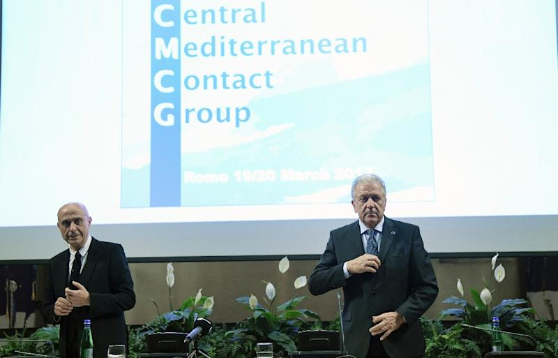 """EU Commissioner for Migration, Home Affairs and Citizenship Dimitris Avramopoulos (R) and  Italy's Interior Minister Marco Minniti look on during the """"Central Mediterranean contact group"""" meeting on March 20, 2017 in Rome"""