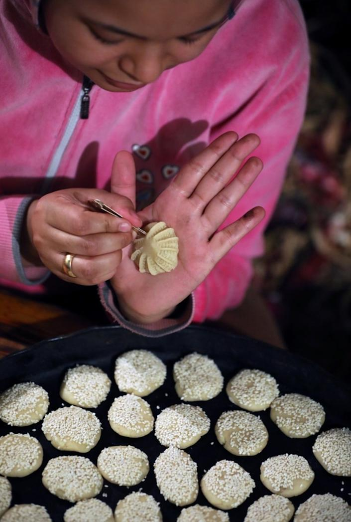 And women in northern Egypt prepare shortbread cookies called Kahk on Saturday.