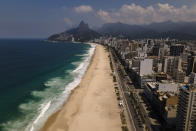 Copacabana beach sits empty of visitors which is closed due to reinstated COVID-19 pandemic restrictions in Rio de Janeiro, Brazil, Saturday, March 20, 2021. (AP Photo/Lucas Dumphreys)