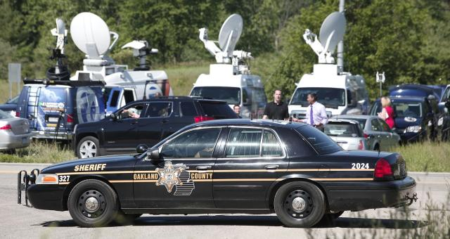 OAKLAND TOWNSHIP, MI - JUNE 17: News trucks gather at the location where FBI agents are searching a field for the remains of former Teamsters' union president Jimmy Hoffa June 17, 2013 in Oakland Township, Michigan. The agents were acting on a tip provided by Tony Zerilli, 85, a former mobster, who was released from prison in 2008. Hoffa, who had reported ties to organized crime, went missing in July of 1975. (Photo by Bill Pugliano/Getty Images)
