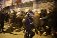 Riot policemen clash with demonstrators during a protest condemning the arrest of rap singer Pablo Hasél in Barcelona, Spain, Saturday, Feb. 20, 2021. A fifth night of peaceful protests to denounce the imprisonment of a Spanish rap artist once more devolved into clashes between police and fringe group members who set up street barricades and smashed storefront windows in Barcelona. (AP Photo/Joan Mateu)