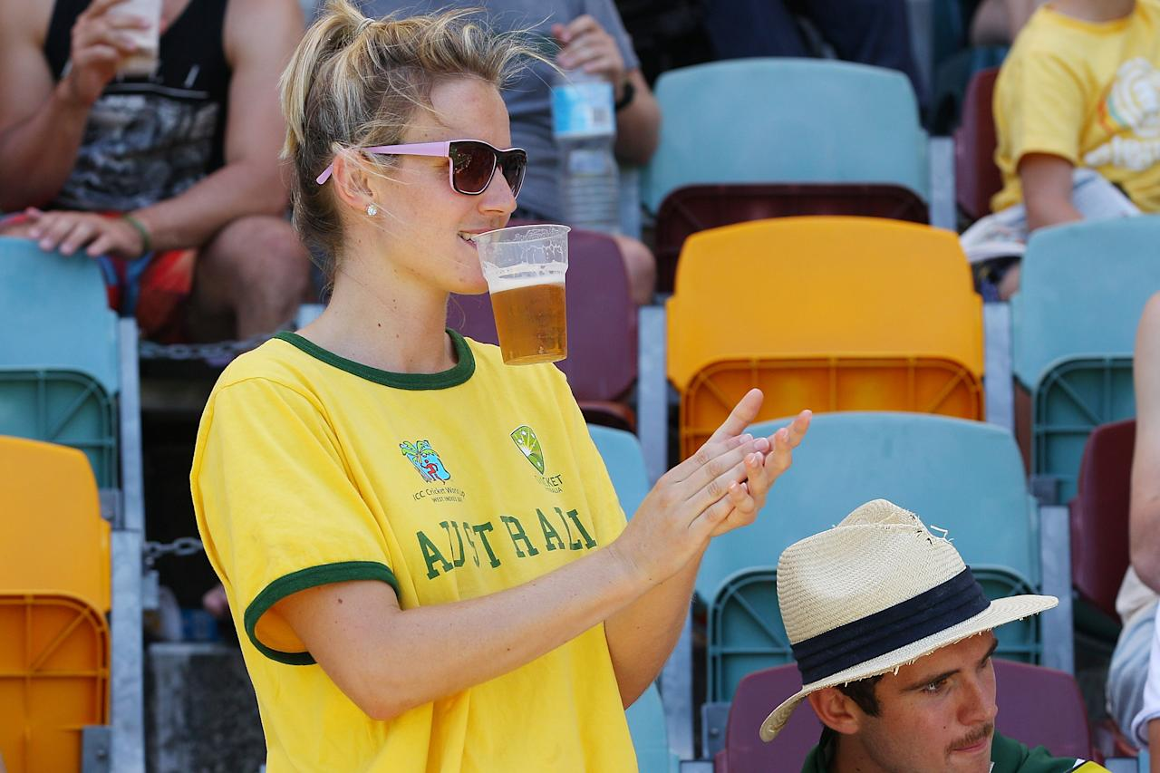 BRISBANE, AUSTRALIA - NOVEMBER 13:  Fans cheer during day five of the First Test match between Australia and South Africa at The Gabba on November 13, 2012 in Brisbane, Australia.  (Photo by Chris Hyde/Getty Images)