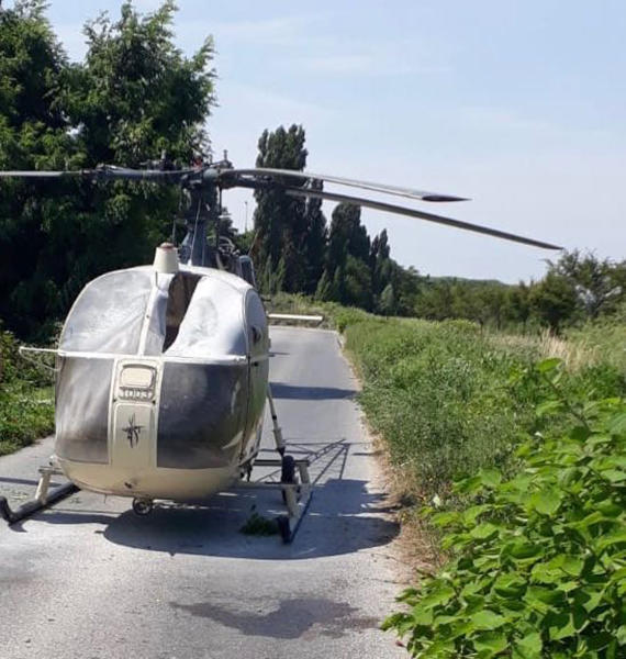 This photo taken on Sunday, July 1, 2018 and provided on Monday, July 2, 2018 by the AP on the condition that its source not be revealed shows an helicopter abandoned by notorious French criminal Redoine Faid after his escape from a prison, in Gonesse, north of Paris, France. Faid serving 25 years for murder made an audacious escape from prison Sunday after a helicopter carrying several heavily armed commandos landed in a courtyard, freed him from a visiting room and carried him away. (AP Photo)