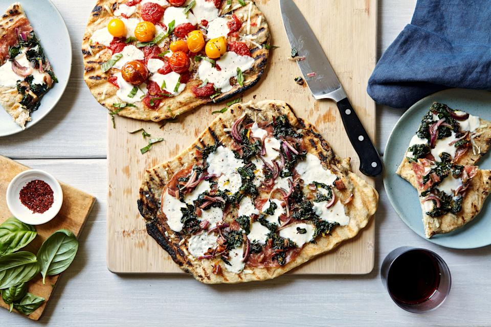 "This grilled pizza recipe is a mix-and-match situation, so feel free to use any and all of the toppings below or choose your own. The quickly wilted leafy greens take on a pesto-ish vibe when combined with garlic, grated Parmesan, and lots of bright lemon zest. They're especially good when dolloped on a pie with cured meat and salty cheese. Add juicy burst tomatoes, Swiss chard, tomato passata, and/or <a href=""https://www.epicurious.com/recipes/food/views/rosemary-agrodolce-for-pizza?mbid=synd_yahoo_rss"" rel=""nofollow noopener"" target=""_blank"" data-ylk=""slk:Rosemary Agrodolce"" class=""link rapid-noclick-resp"">Rosemary Agrodolce</a>, as the mood strikes you. (The agrodolce brings a balanced mix of sweet, salty, acidic, and herbaceous flavors that complement virtually any pizza.) You can certainly use all-purpose flour in place of the bread flour in the dough, but be aware that the finished crusts will be less chewy and more fluffy if you go that route. <a href=""https://www.epicurious.com/recipes/food/views/grilled-pizza-best-dough-toppings-grilling?mbid=synd_yahoo_rss"" rel=""nofollow noopener"" target=""_blank"" data-ylk=""slk:See recipe."" class=""link rapid-noclick-resp"">See recipe.</a>"