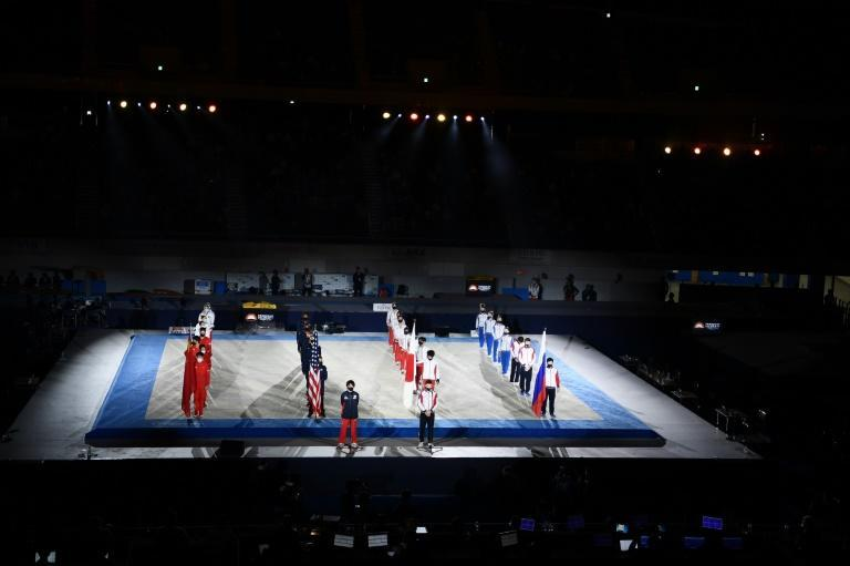 Athletes stand during the opening ceremony of a gymnastics Friendship and Solidarity Competition in Tokyo
