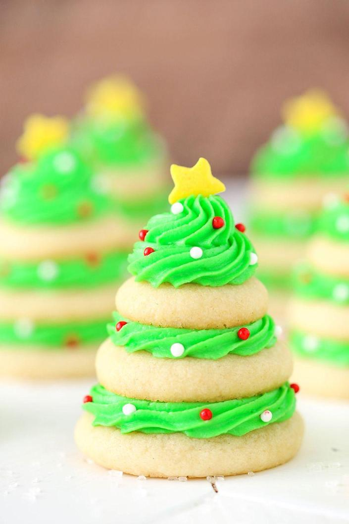"""<p>Ask yourself, would you rather decorate a real tree, or a sugar cookie Christmas tree?</p><p>Get the recipe from <a href=""""https://www.delish.com/cooking/recipe-ideas/recipes/a50445/christmas-tree-cookie-stacks/"""" rel=""""nofollow noopener"""" target=""""_blank"""" data-ylk=""""slk:Delish"""" class=""""link rapid-noclick-resp"""">Delish</a>.</p>"""