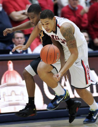 Arizona's Brandon Ashley, right, struggles with Long Beach State's Mike Caffey for a loose ball during the first half of an NCAA college basketball game in Tucson, Ariz., Monday, Nov. 19, 2012. (AP Photo/John Miller)