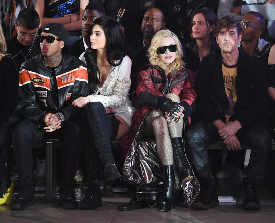 <p>Kylie Jenner and Madonna sat next to each other on the front row with Kylie opting for a white mini dress and Madonna choosing a printed coat. <i>[Photo: Getty]</i> </p>