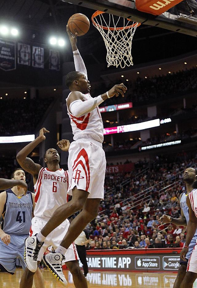Houston Rockets forward Dwight Howard grabs a rebound as Terrence Jones (6) watches during the first half of an NBA basketball game against the Memphis Grizzlies on Thursday, Dec. 26, 2013, in Houston. (AP Photo/Bob Levey)