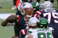 New England Patriots quarterback Cam Newton passes under pressure from New York Jets defensive end Henry Anderson in the first half of an NFL football game, Sunday, Jan. 3, 2021, in Foxborough, Mass. (AP Photo/Charles Krupa)