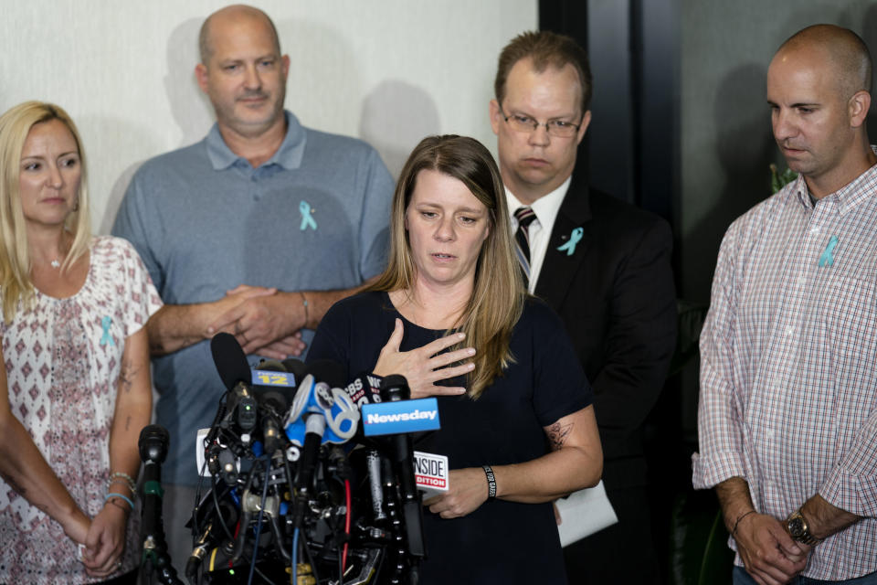 Nichole Schmidt, mother of Gabby Petito, whose death on a cross-country trip has sparked a manhunt for her boyfriend Brian Laundrie, speaks alongside, from left, Tara Petito, stepmother, Joseph Petito, father, Richard Stafford, family attorney, and Jim Schmidt, stepfather, during a news conference, Tuesday, Sept. 28, 2021, in Bohemia, N.Y. (AP Photo/John Minchillo)