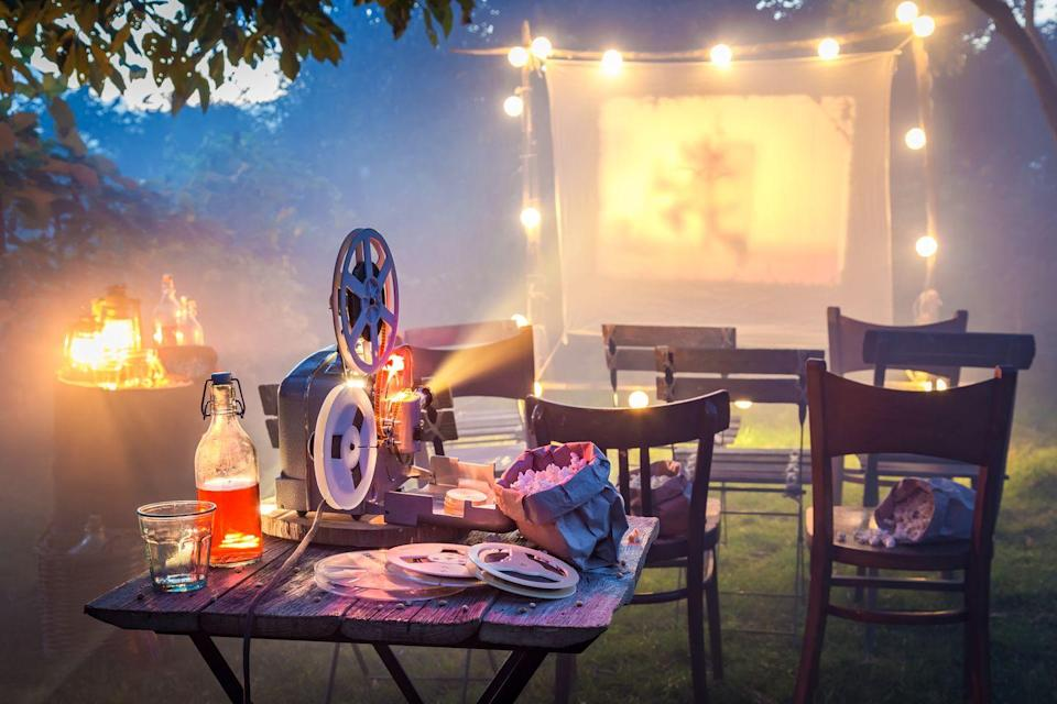 """<p>Weather permitting, set up an <a href=""""http://www.countryliving.com/entertaining/a32945750/outdoor-movie-theater/"""" rel=""""nofollow noopener"""" target=""""_blank"""" data-ylk=""""slk:outdoor movie theater"""" class=""""link rapid-noclick-resp"""">outdoor movie theater</a> and cozy seating on your lawn, then sit back and relax with some of the <a href=""""https://www.countryliving.com/life/entertainment/g27725000/best-patriotic-movies/"""" rel=""""nofollow noopener"""" target=""""_blank"""" data-ylk=""""slk:best patriotic movies"""" class=""""link rapid-noclick-resp"""">best patriotic movies</a> like <em>Yankee Doodle Dandy</em> or <em>Miracle</em>. Of course, if it rains, you can easily move the festivities, popcorn and all, into the family room. </p><p><a class=""""link rapid-noclick-resp"""" href=""""https://www.amazon.com/Perfectware-1oz-Popcorn-Bag-125ct/dp/B07P18LPXD/?tag=syn-yahoo-20&ascsubtag=%5Bartid%7C10050.g.4463%5Bsrc%7Cyahoo-us"""" rel=""""nofollow noopener"""" target=""""_blank"""" data-ylk=""""slk:SHOP POPCORN BAGS"""">SHOP POPCORN BAGS</a></p>"""